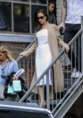 Angelina Jolie steps out of a building through a fire escape in Toronto, Canada