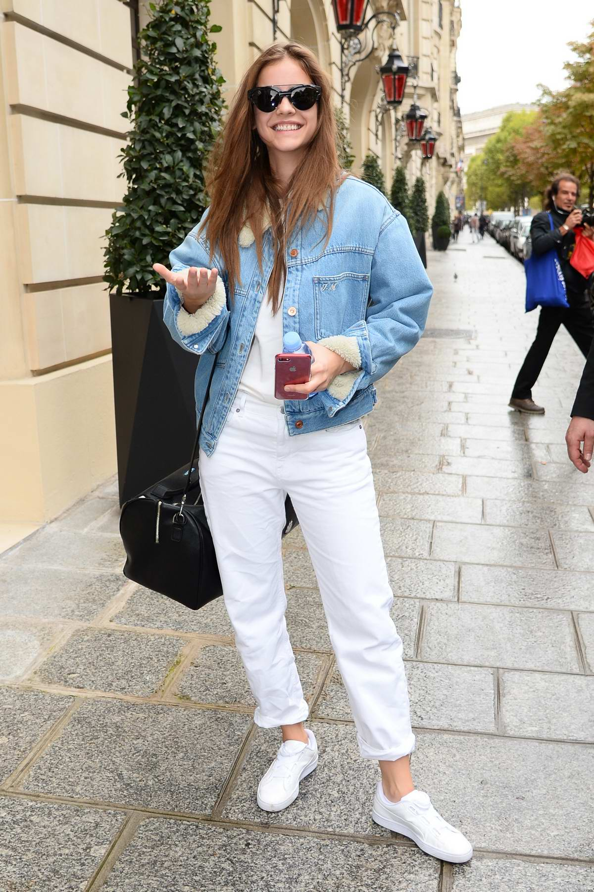 Barbara Palvin rocking all white with a blue denim jacket out during spring summer 2018 Fashion Week in Paris, France