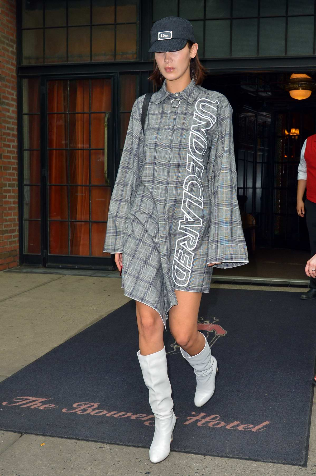 Bella Hadid steps out of Bowery Hotel wearing a plaid dress in New York City