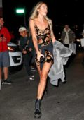 Candice Swanepoel grabs a taxi after attending the Alexander Wang Show during New York Fashion Week