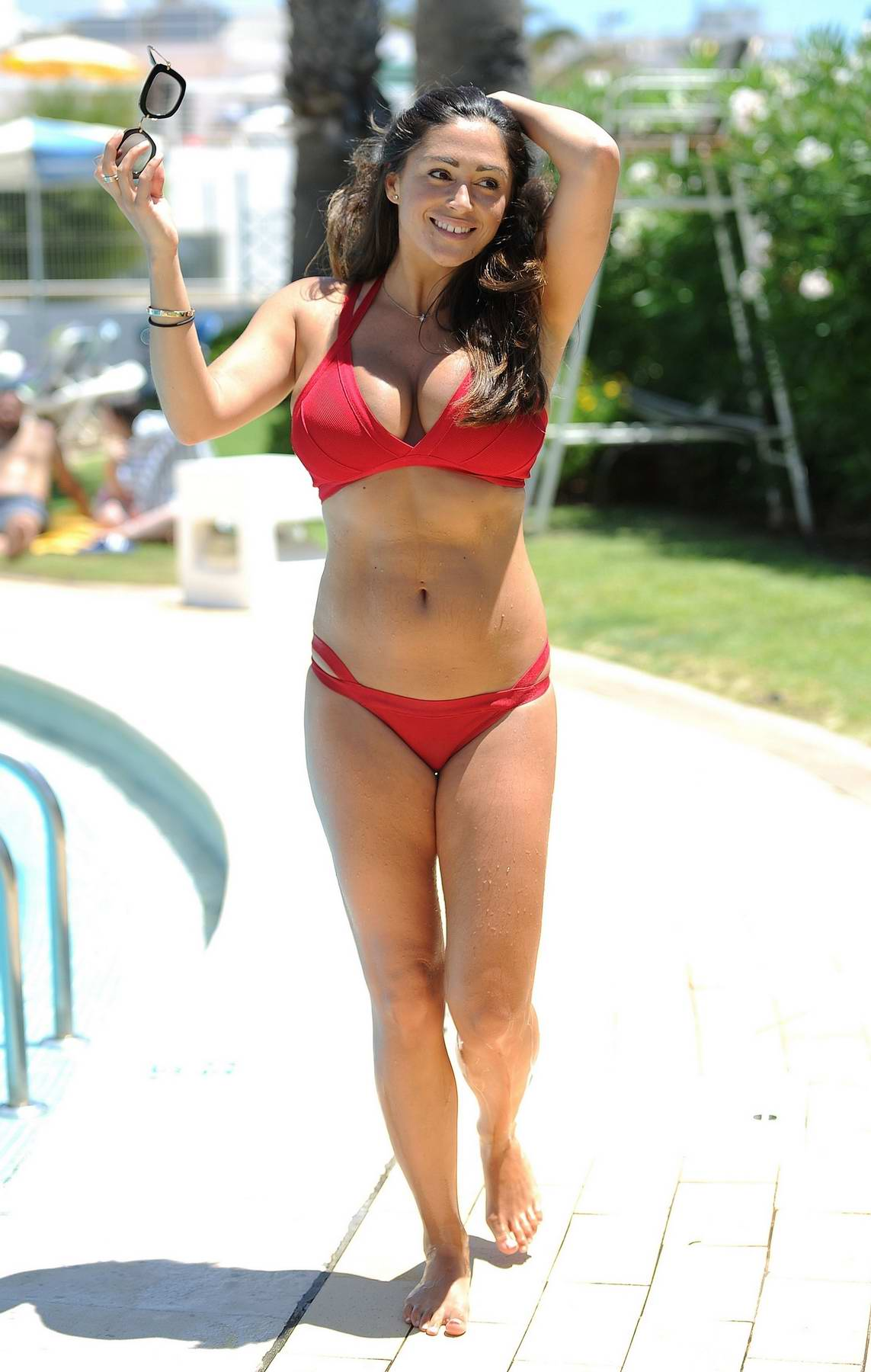 Casey Batchelor in a red bikini on a holiday in Spain