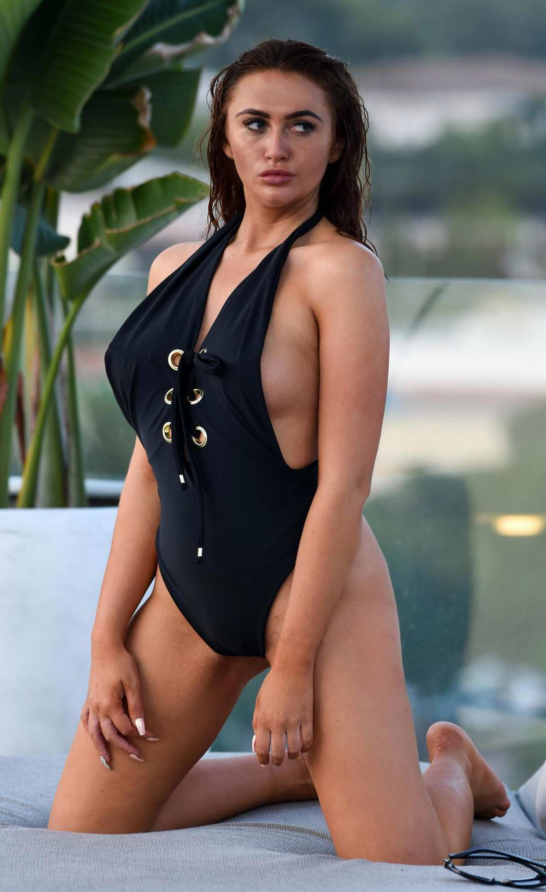 Charlotte Dawson wearing black swimsuit while taking a break from filming at a 5 star hotel in Greece