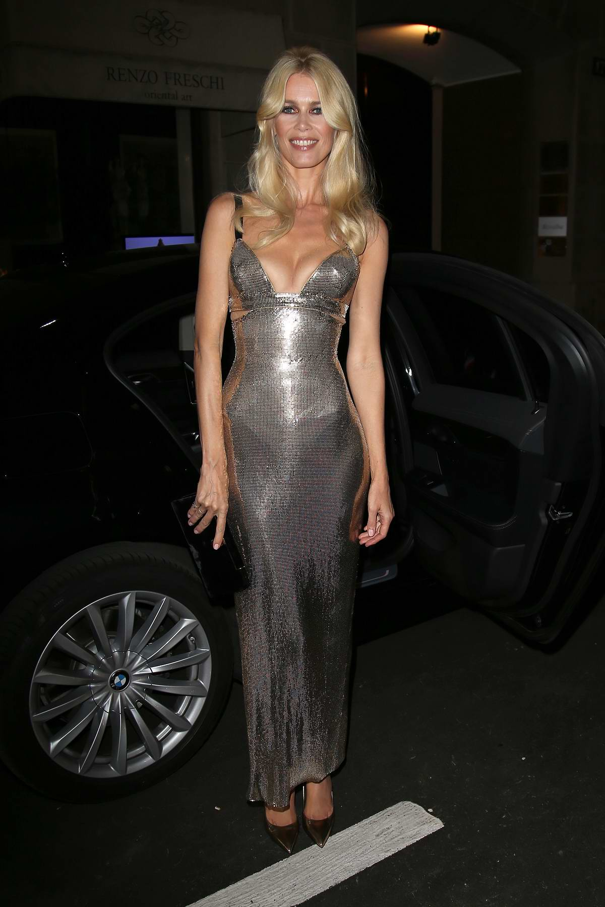Claudia Schiffer arrives at Versace dinner party during Milan Fashion Week, Italy