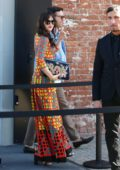 Dakota Johnson in a colorful dress arriving at the Gucci Show during Milan Fashion Week, Italy
