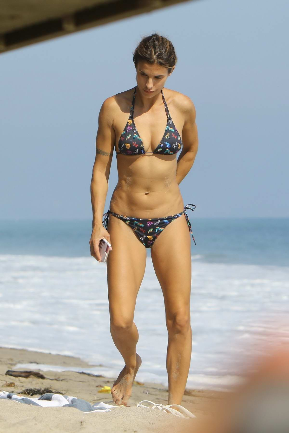 Elisabetta Canalis in bikini relaxing at the beach in Malibu