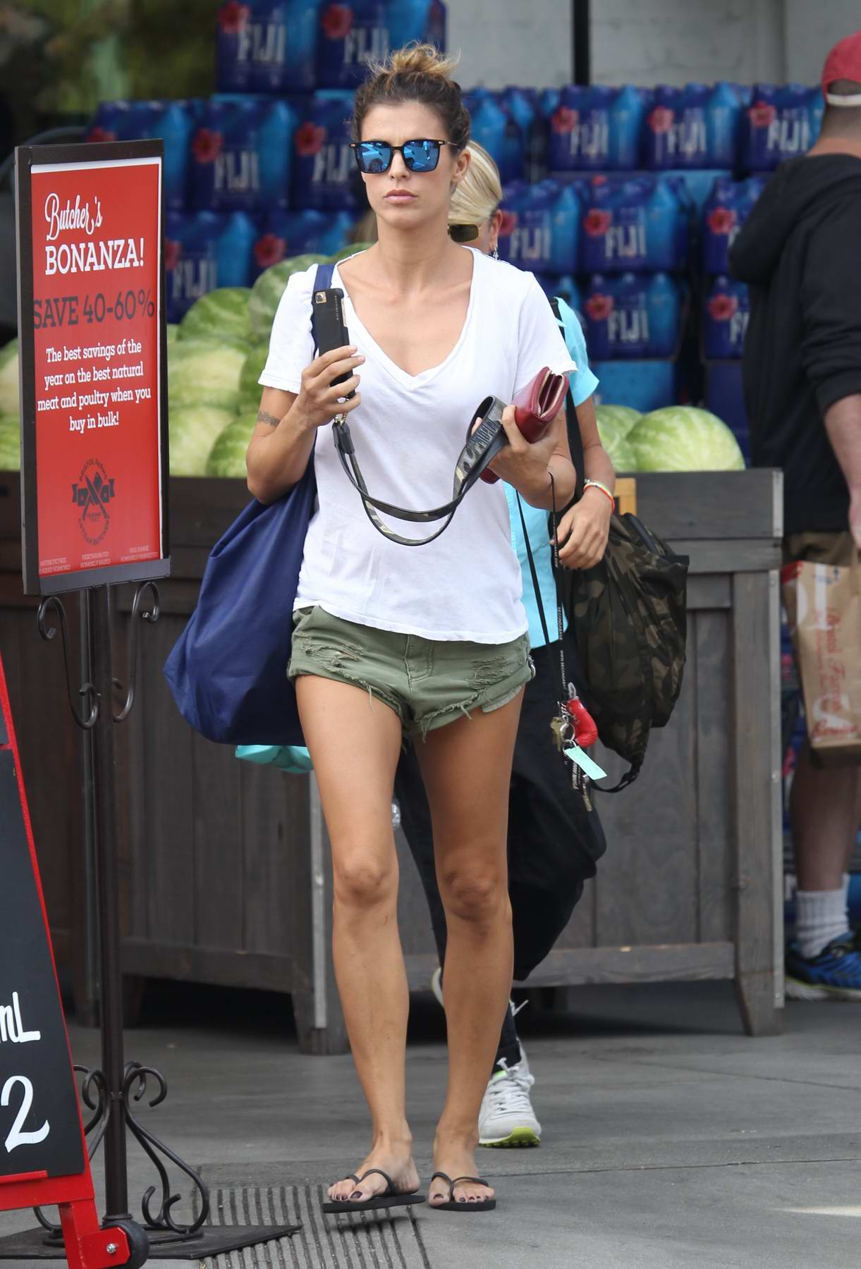 Elisabetta Canalis in white tee and green shorts leaves Bristol Farms in Beverly Hills, Los Angeles