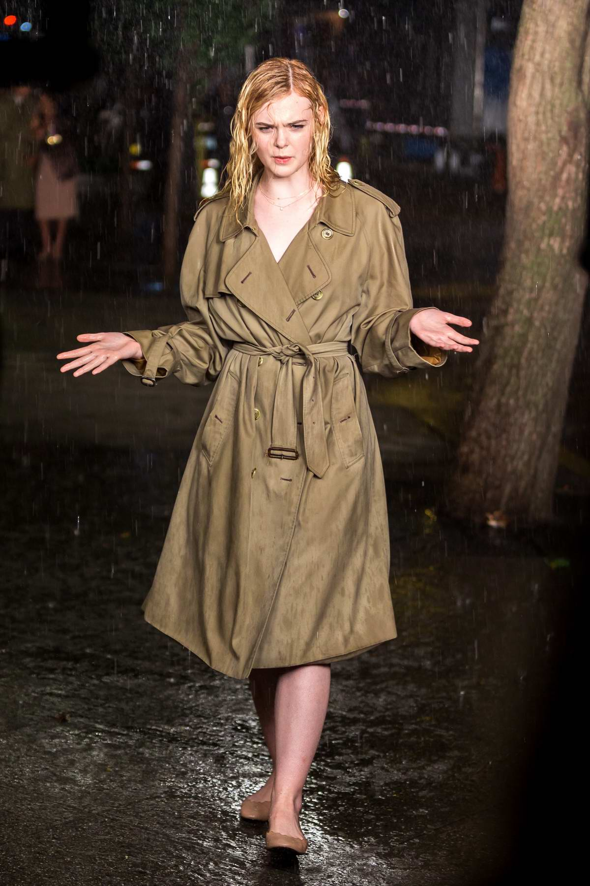 Elle Fanning shooting a rain scene on the set of untitled Woody Allen project in New York
