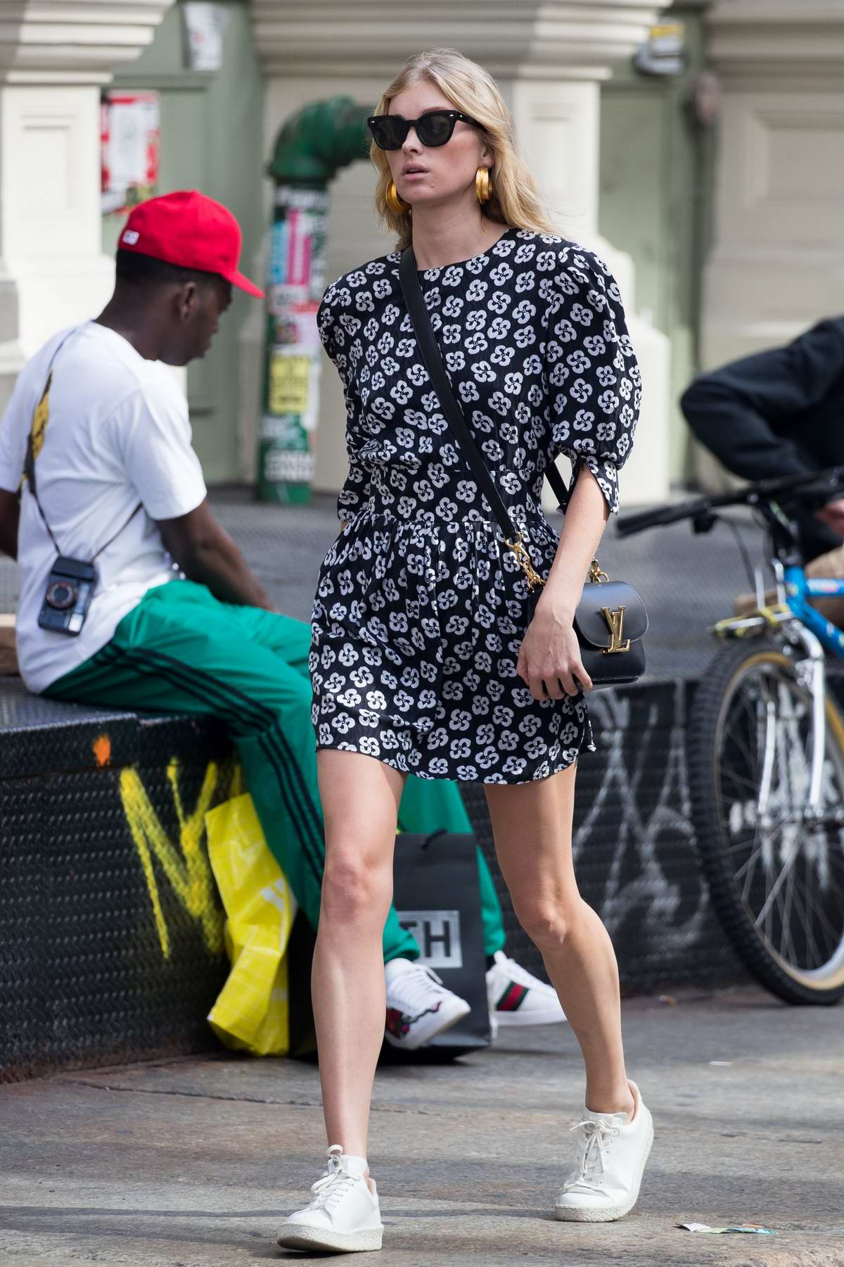 Elsa Hosk in a short dress and white sneakers out and about during fashion week in New York City