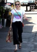 Emma Roberts grabs a bag of groceries at Bristol Farms in West Hollywood, Los Angeles