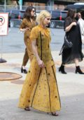 Emma Roberts in a yellow dress attends the Coach Fashion Show in New York