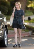 Emma Roberts wears a flower printed dress while visiting Big Sugar Bake Shop in Los Angeles
