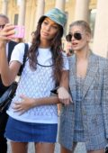 Hailey Baldwin and Joan Smalls take selfies after walking the runway for Alberto Ferretti, spring summer 2018 during Milan Fashion Week in Milan, Italy