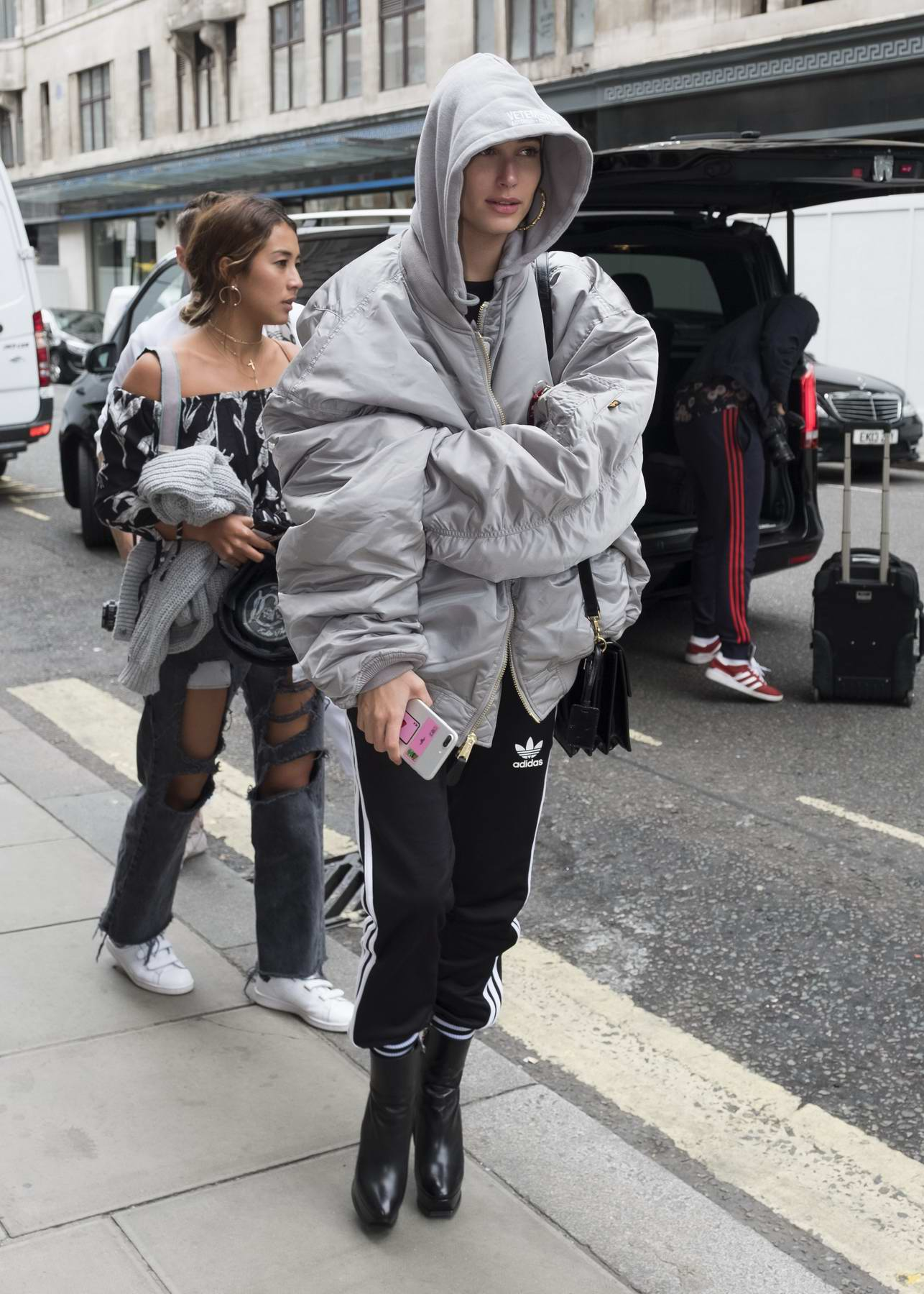 Hailey Baldwin wears an oversize silver jacket while out and about in London