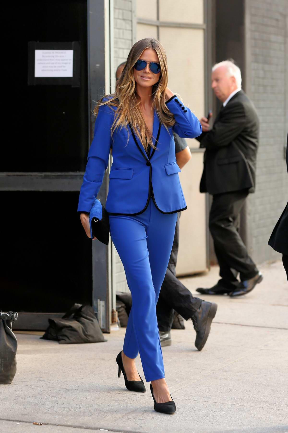 Heidi Klum in a blue pants suit leaves Art Beam in New York