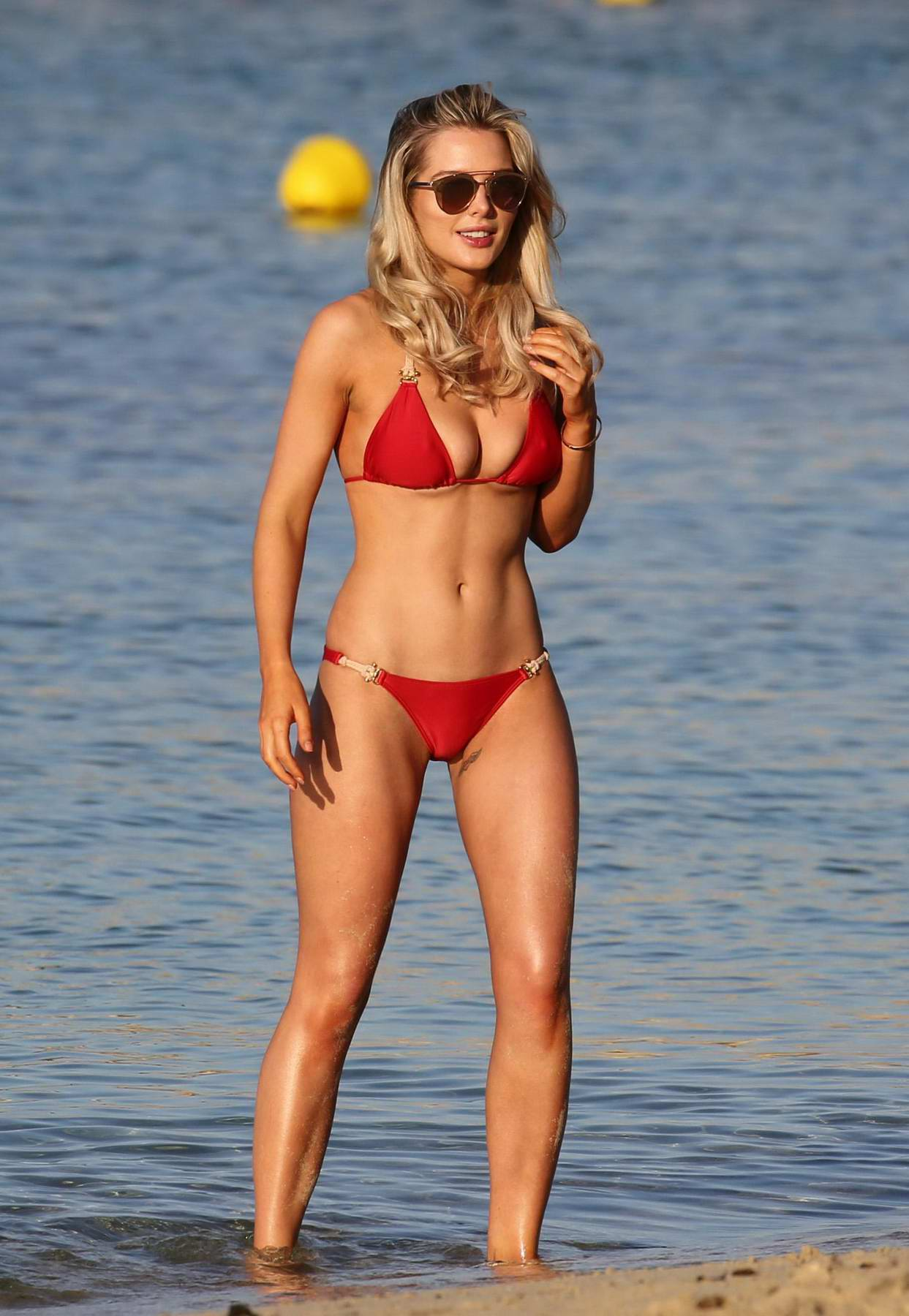 Helen flanagan in a red bikini enjoying her holidays on the beach in Dubai