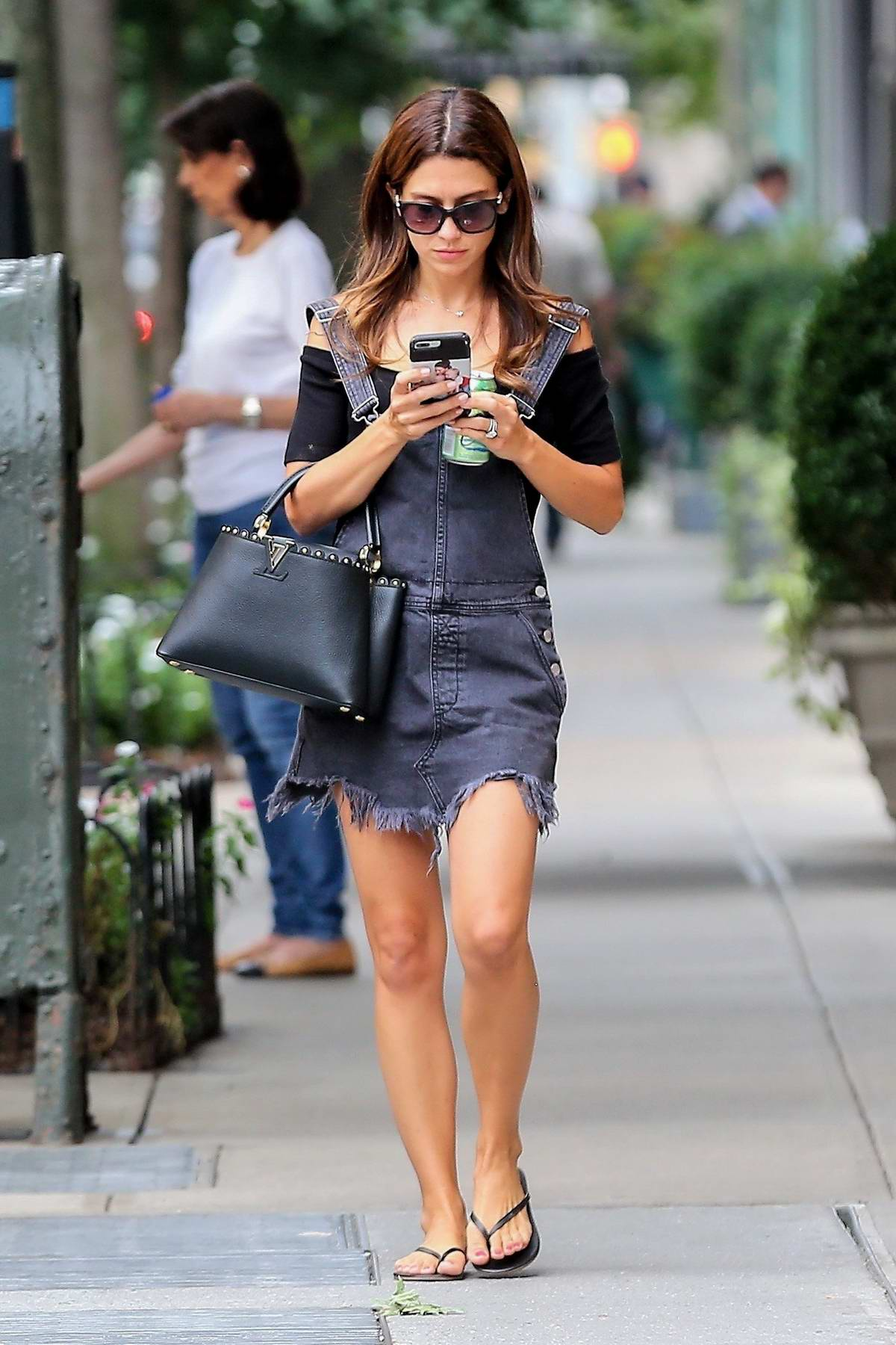 Hilaria Baldwin busy on her phone as she walks to the nearby hair salon in the West Village, New York