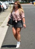Hilary Duff wears a denim mini skirt leaving a salon in West Hollywood, Los Angeles