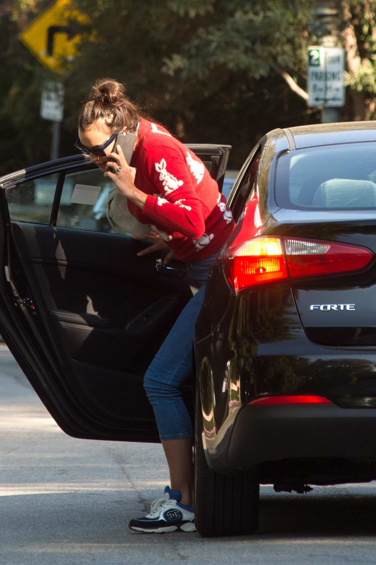 Irina Shayk in red sweater and cropped jeans spotted stepping out in for a pedicure in Los Angeles