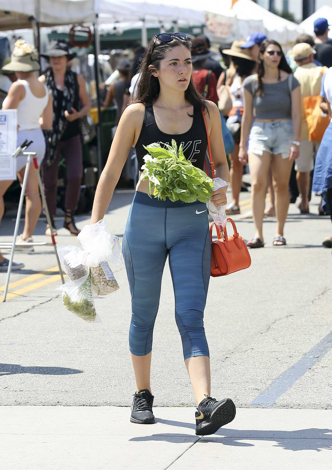 Isabelle Fuhrman shops at a farmers market in Los Angeles