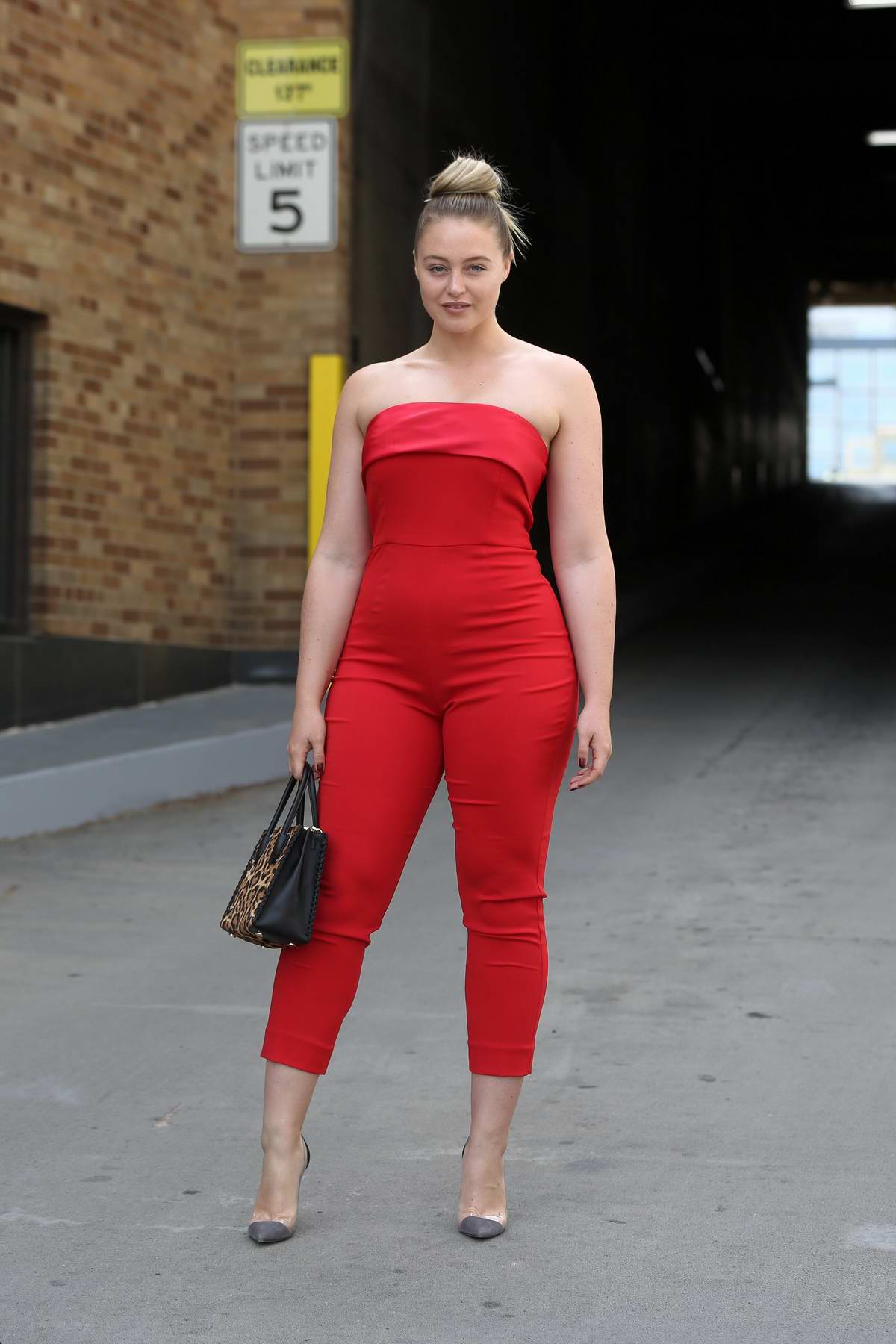 Iskra Lawrence wearing a red jumpsuit, attends Badgley Mischka spring summer 2018 at Skylight Clarkson during New York Fashion Week