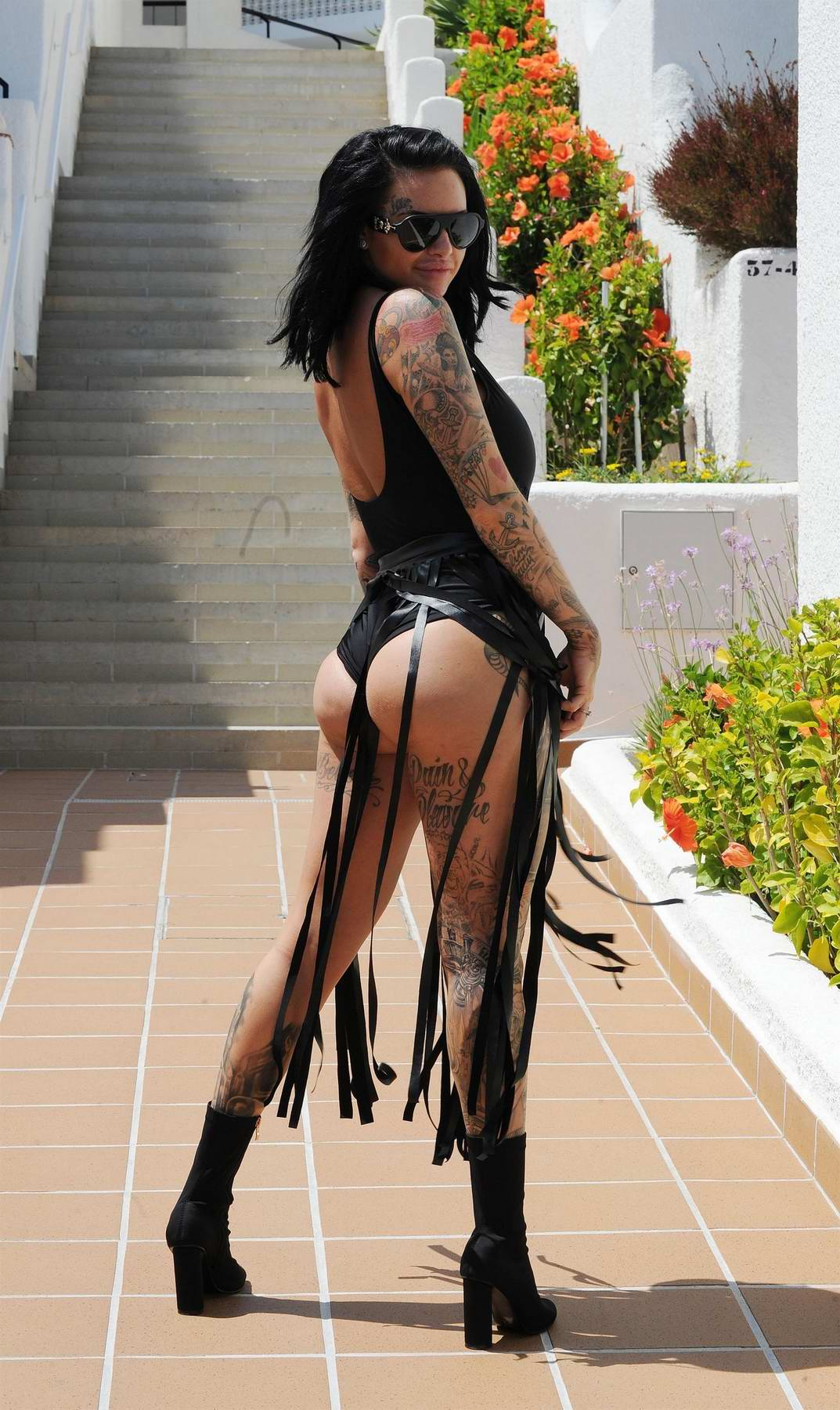 Jemma Lucy in a tasseled swimsuit at a pool party in Spain