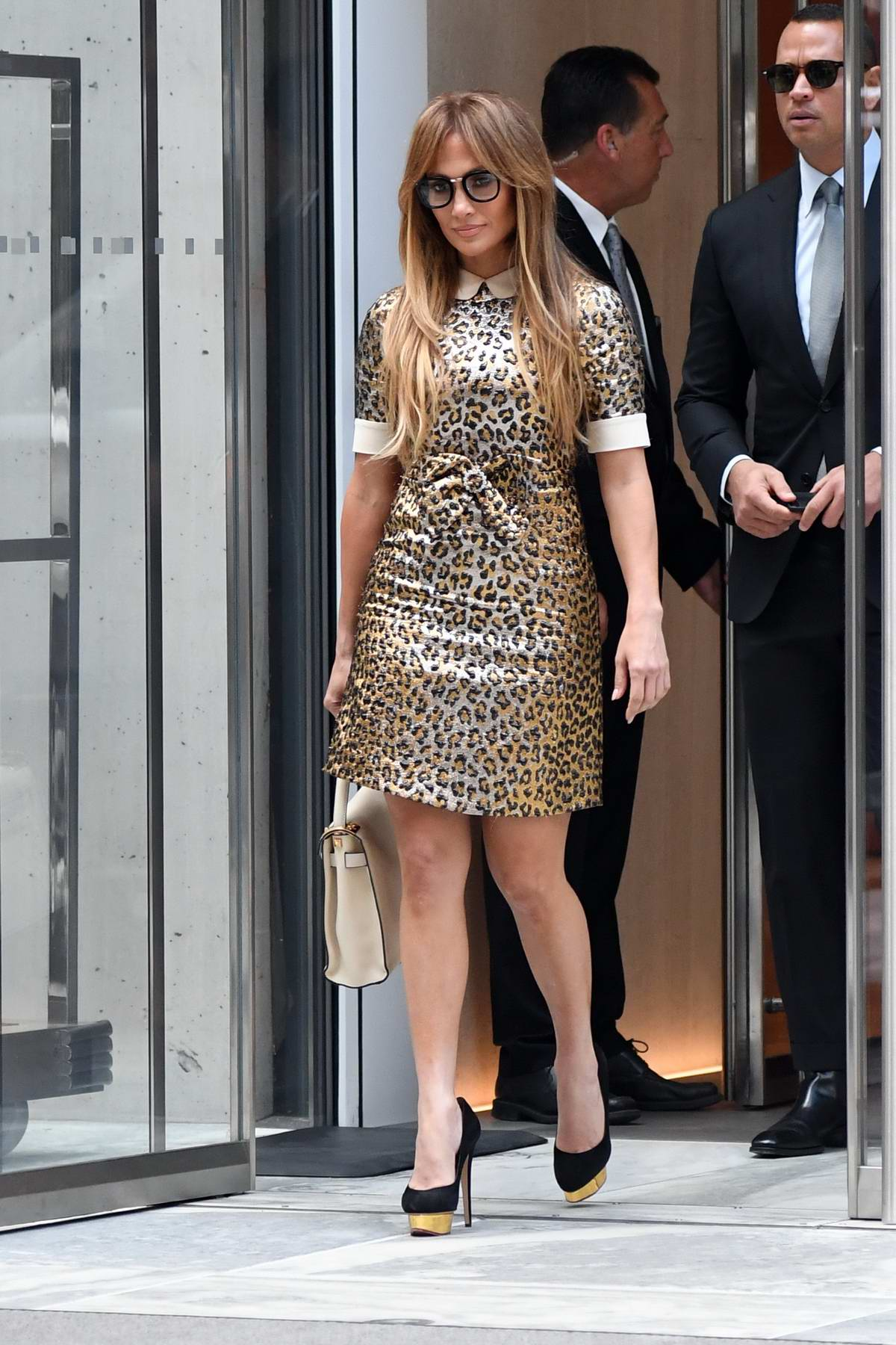 Jennifer Lopez in a leopard print dress heads out with Alex Rodriguez in New York