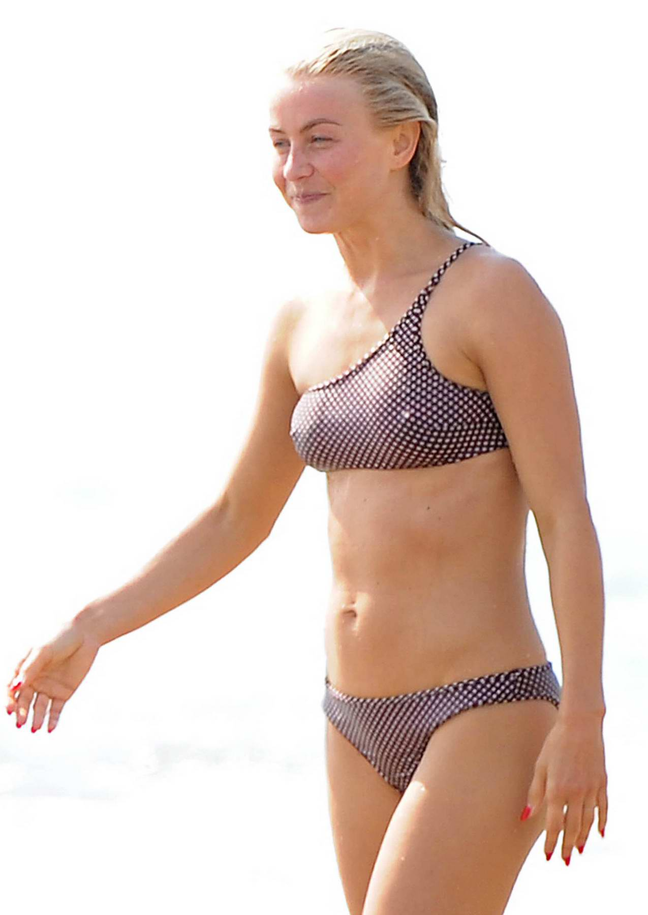 Julianne Hough in a bikini while body-surfing with husband Brooks Laich at the beach in Manhattan Beach, California