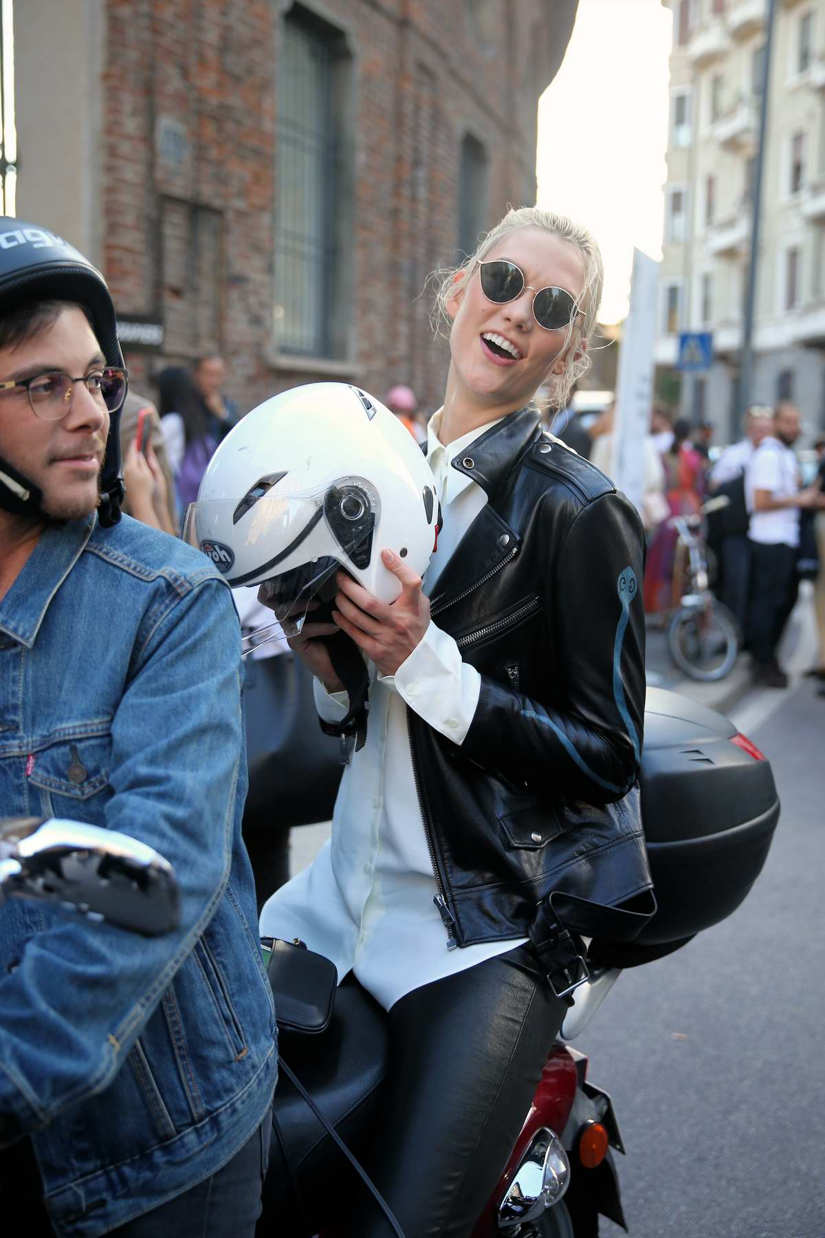Karlie Kloss rides off on a motorcycle after walking the runway at Alberto Ferretti, spring summer 2018 during Milan Fashion Week, Italy