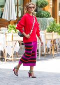 Kat Graham in a bright red and pink outfit spotted out and about in Milan, Italy