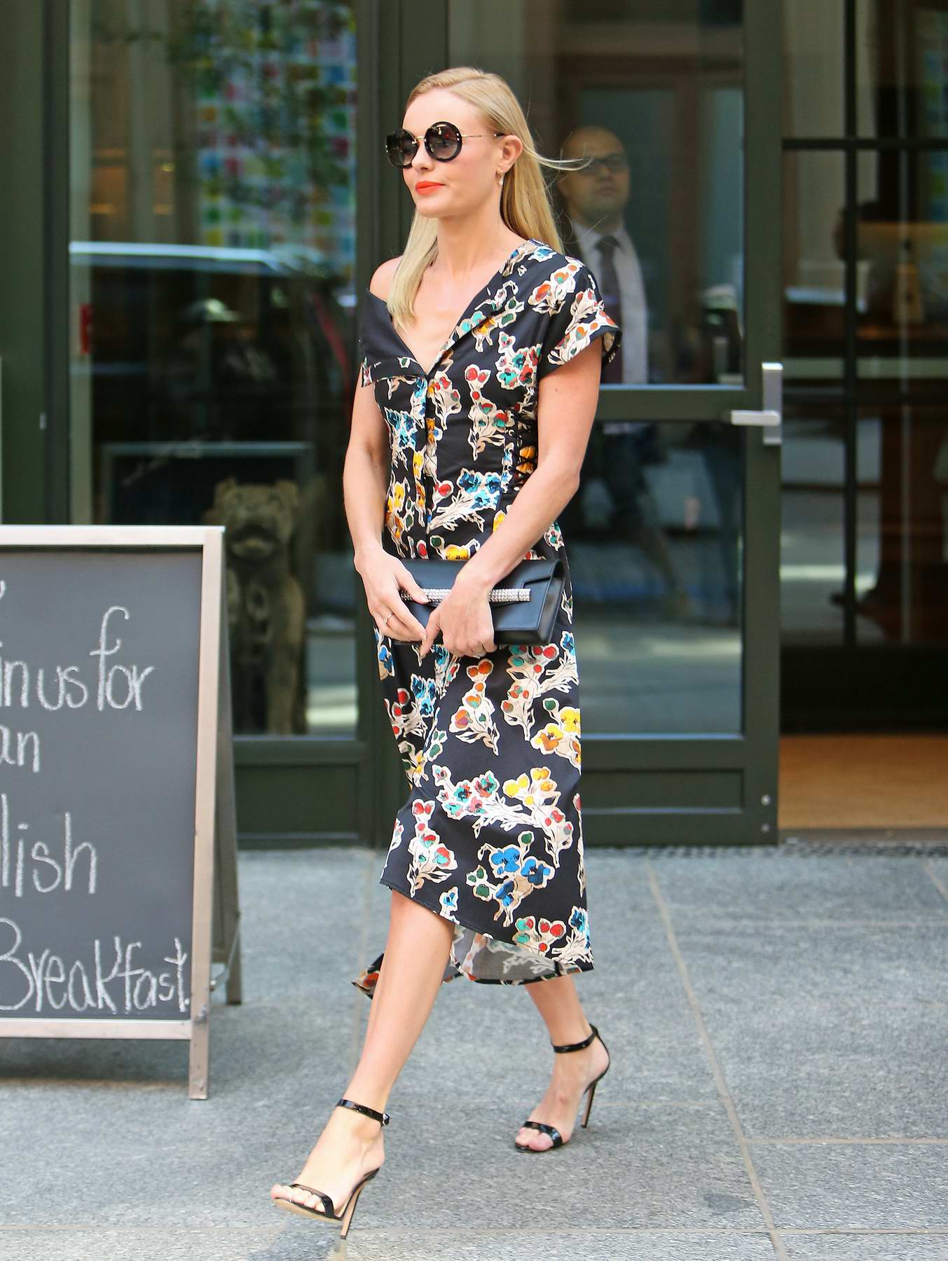 Kate Bosworth steps out wearing a floral dress while leaving her hotel during Fashion Week in New York City