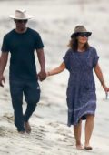 Katie Holmes and Jamie Fox hold hands while taking a walk on the beach in Malibu, California