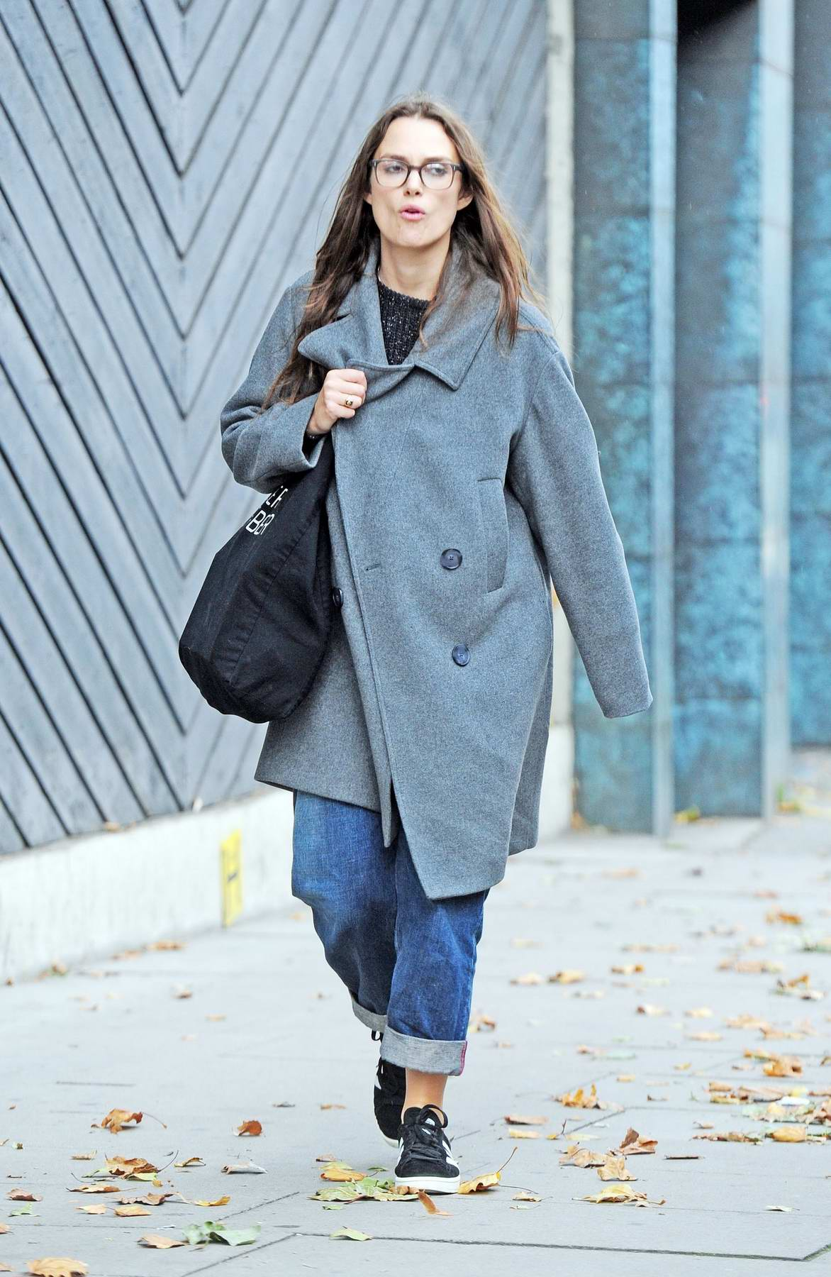 Keira Knightley dressed in a large grey coat and spectacles is spotted running a few errands in London
