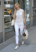 Kelly Rutherford puts her dog in her bag while window shopping on Madison Avenue in New York City