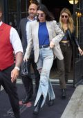 Kendall Jenner wearing distressed denim while arriving at the Tom Ford fashion show in New York