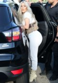 Kim Kardashian in all white leaving the Iceland Skating Center with her kids in Los Angeles