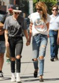 Kristen Stewart and Stella Maxwell hold hands while taking a walk in Manhattan, New York