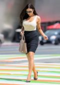 Krystle Lina in a tank top and black pencil skirt while out and about in Los Angeles
