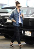 Lily Collins stops for healthy smoothie at Kreation Organic Juicery while out and about in Beverly Hills, California