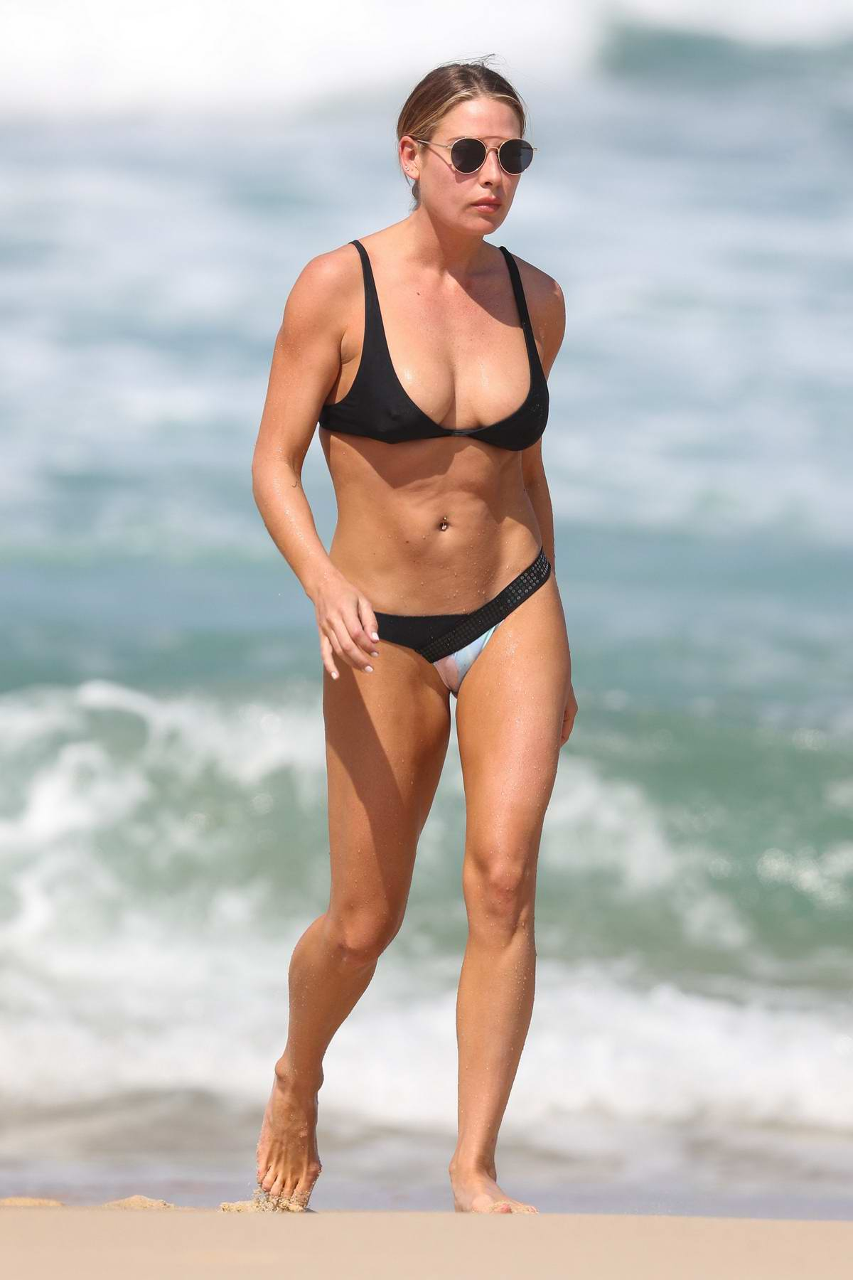 Lisa Clark in a bikini enjoying the beach in Sydney, Australia