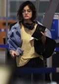 Lucy Hale catches an early morning flight out of Vancouver, Canada