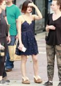 Lucy Hale in a navy blue lace party dress for filming in Vancouver, Canada
