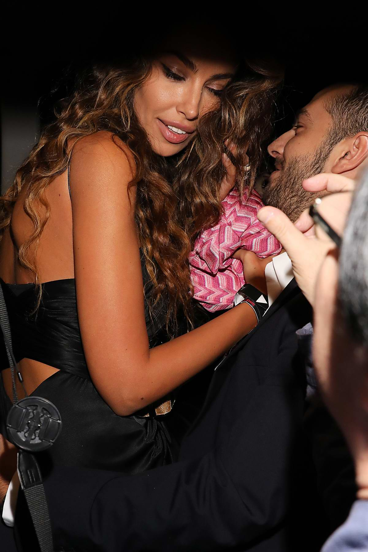 Madalina Ghenea kissing Matei Stratan after the amfAR Gala, spring summer 2018 during Milan fashion week, Italy