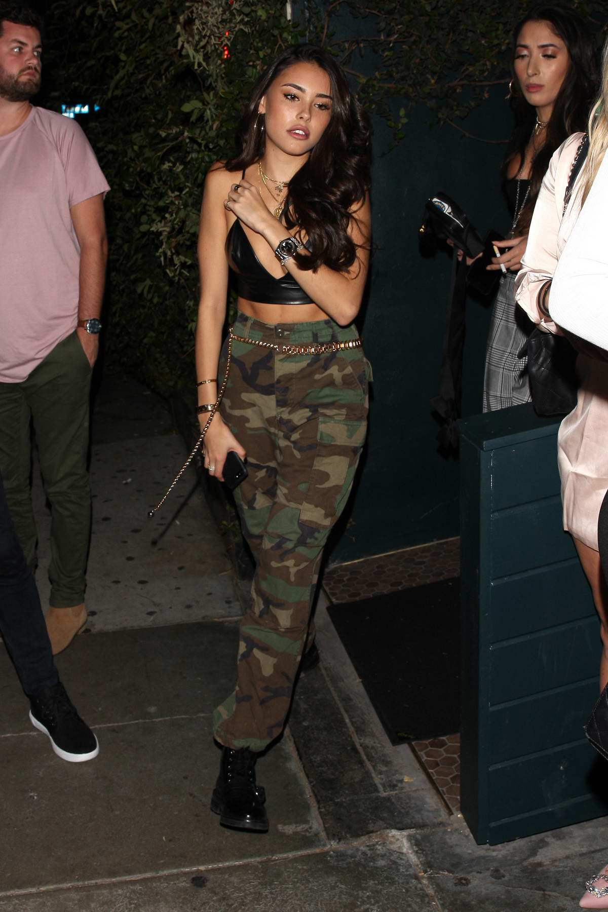 Madison Beer wears a black leather top and camouflage pants as she goes to the Poppy Club with her friends in West Hollywood, Los Angeles