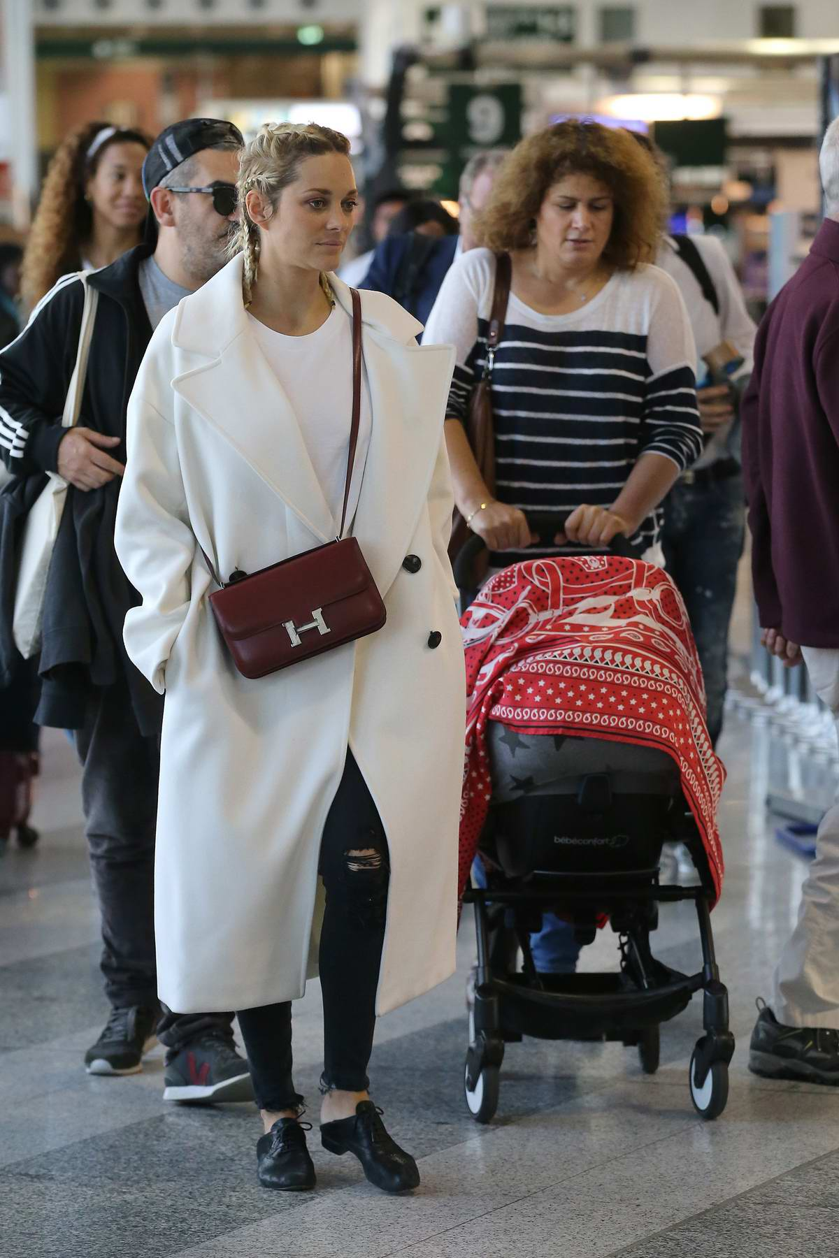 Marion Cotillard Arriving At The Milan Airport With Her