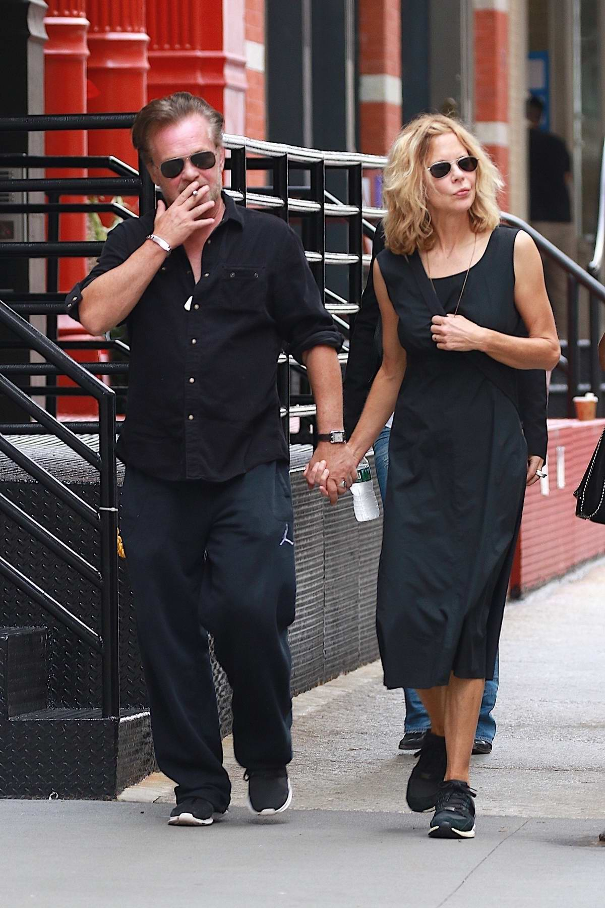 Meg Ryan and John Mellencamp hold hands while out for a walk in New York City