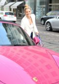 Michelle Hunziker spotted out and about in her pink Porsche in Milan, Italy