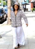 Michelle Rodriguez in a hoodie and a white maxi skirt while out for shopping in Beverly Hills