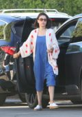 Mila Kunis in a blue jumpsuit running errands in Los Angeles