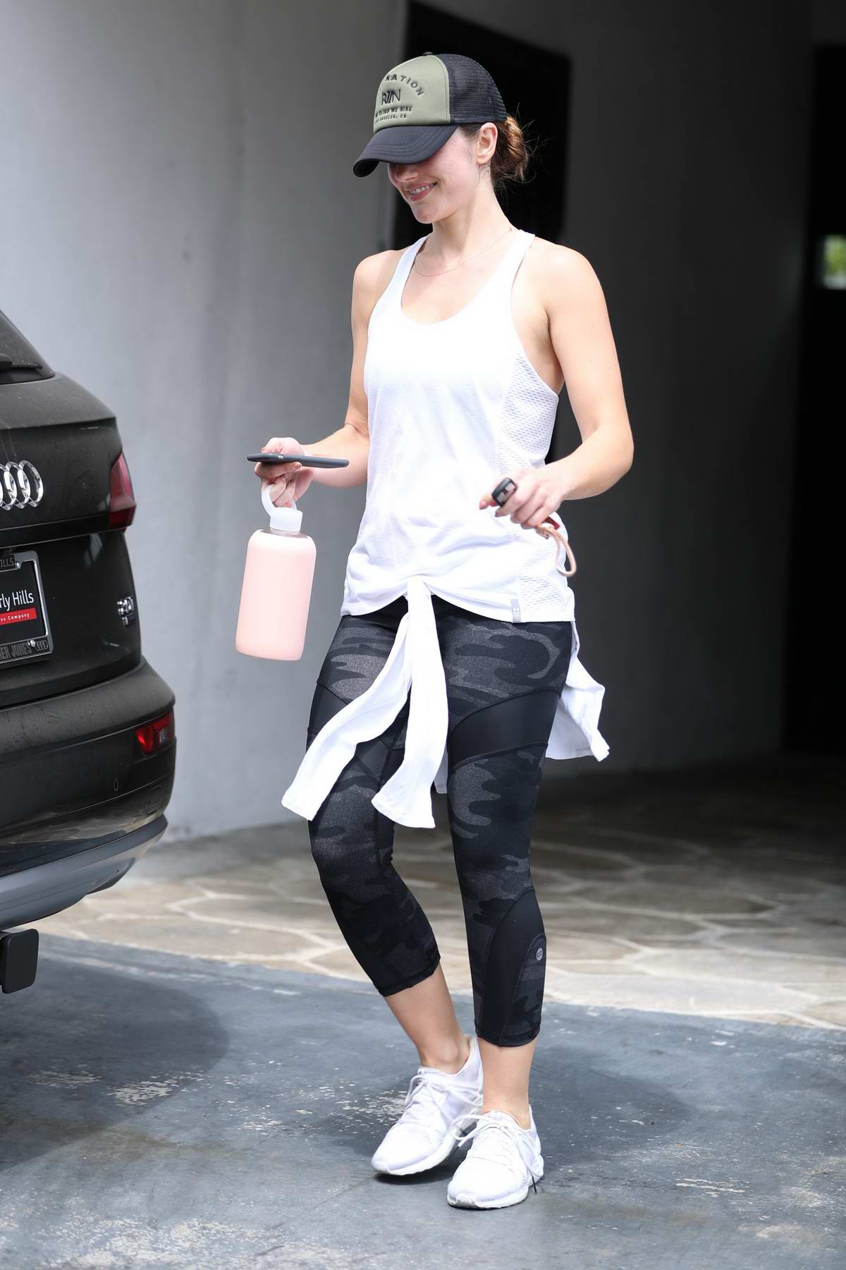 Minka Kelly leaves the gym after a morning workout in West Hollywood, Los Angeles