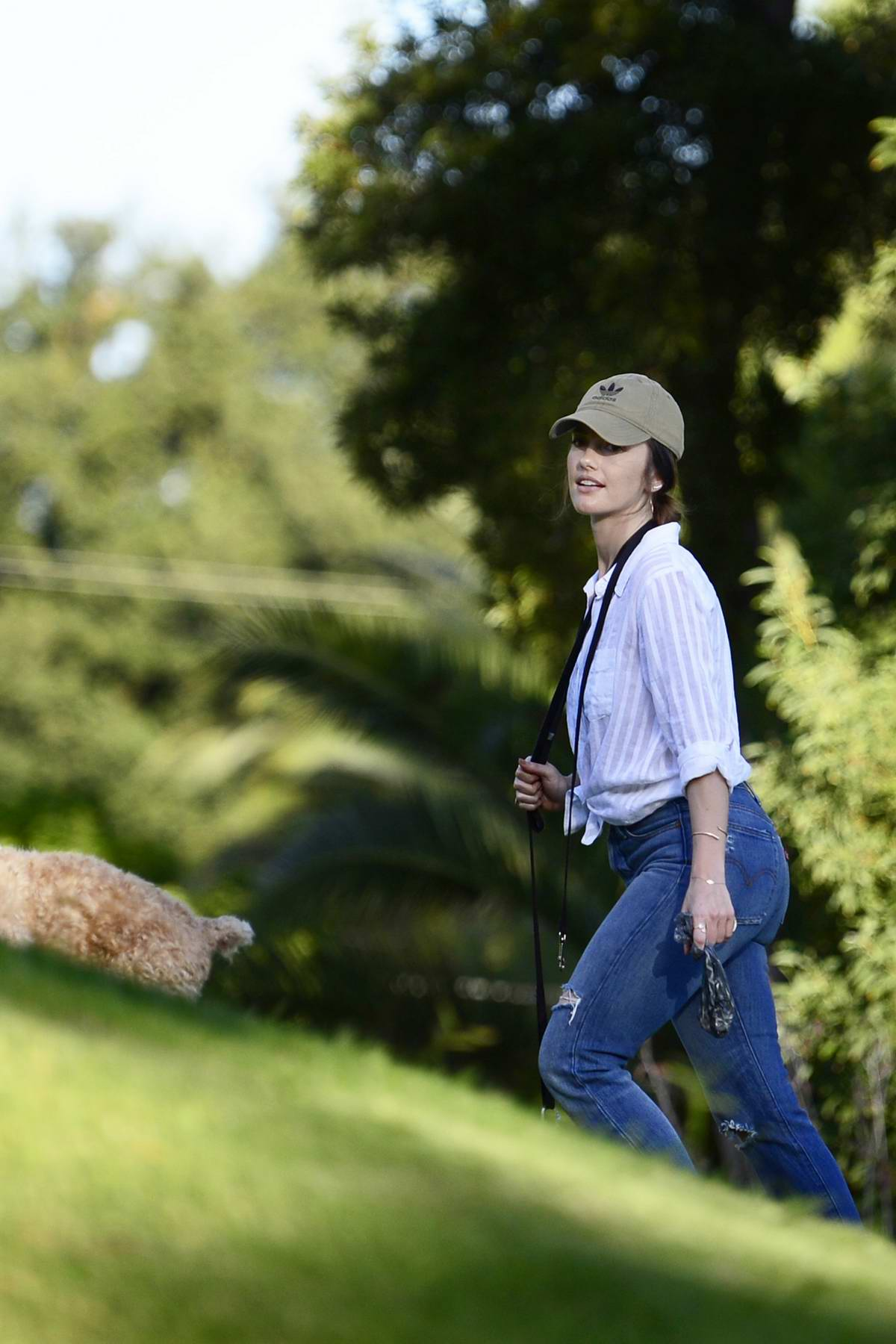 Minka Kelly steps out in a pair of ripped jeans to spend her evening at the park with her dogs in Los Angeles